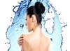 Beautiful female back over water splash background. Back view portrait