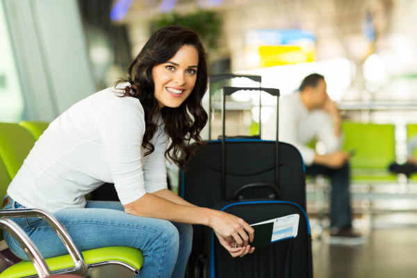 woman waiting for flight at airport