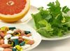 Plate with pills, fruits and herbs on isolated background