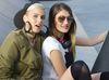 Portrait of two female friends in skate park