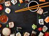 50341368 - traditional japanese food - sushi, rolls and sauce on a dark background. top view